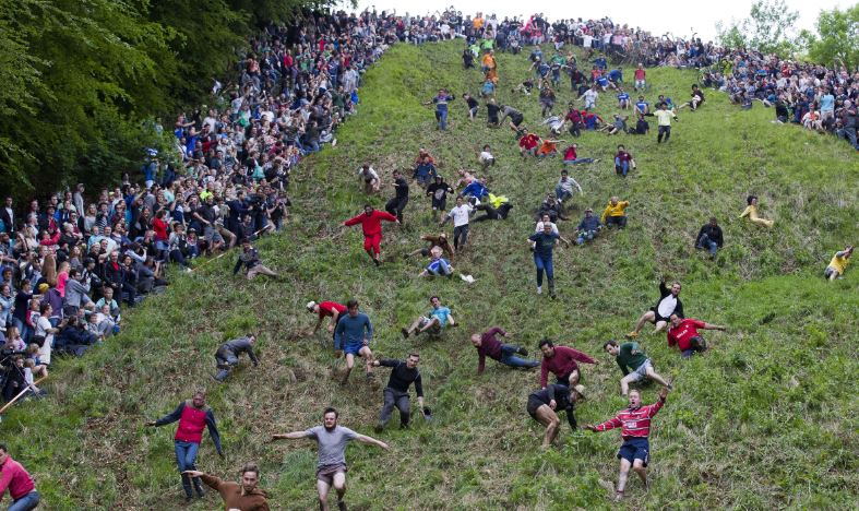 Cooper's Hill Cheese-Rolling And Wake Top Most Famous Bizarre Festivals in World 2018
